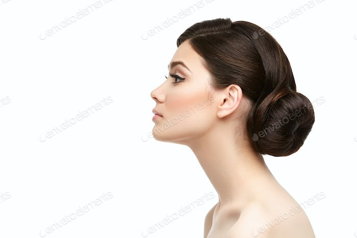 beautiful girl with hairdo isolated on white