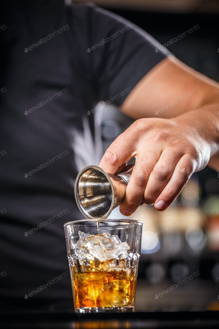 Bartender pouring alcohol