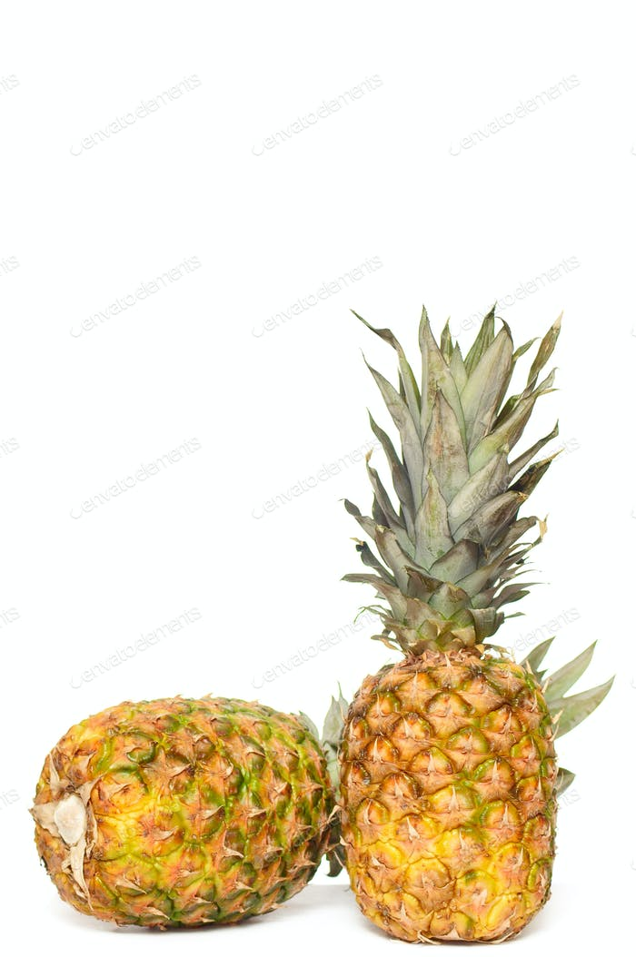 Tasty,fresh pineapples on a white.