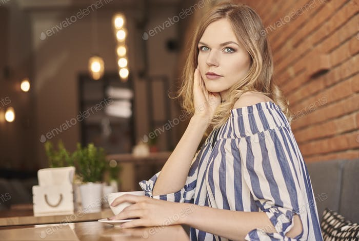 Blond woman hair with cup of coffee