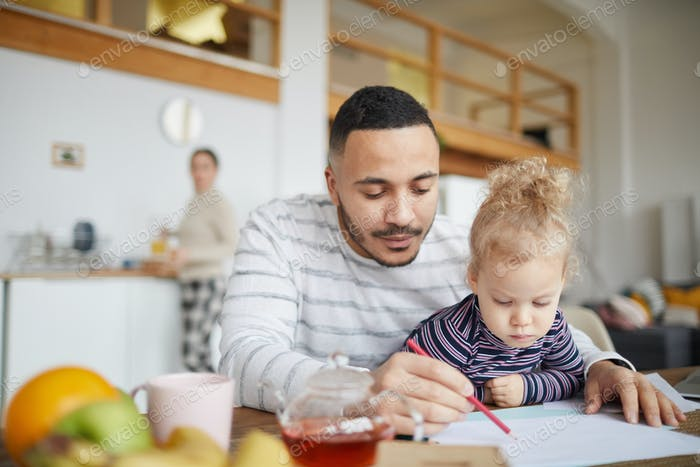 Father Drawing with Cute Little Girl