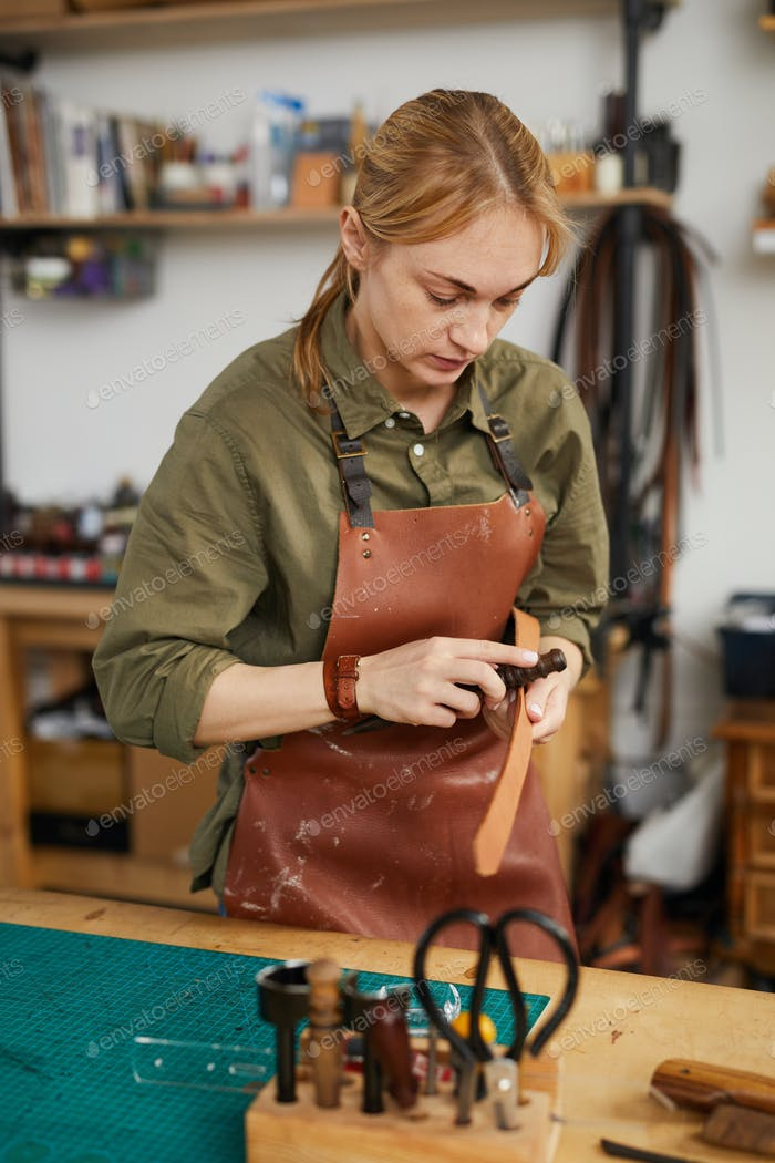 Woman in Leatherworking Studio
