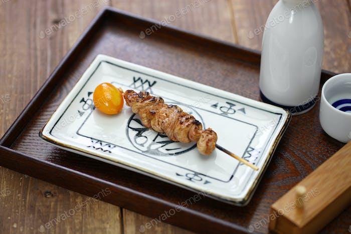 yakitori, japanese grilled chicken skewers, very rare chouchin (immature egg yolk)