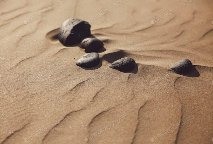 Rocks in sand