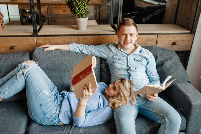 Love couple resting on comfortable couch at home