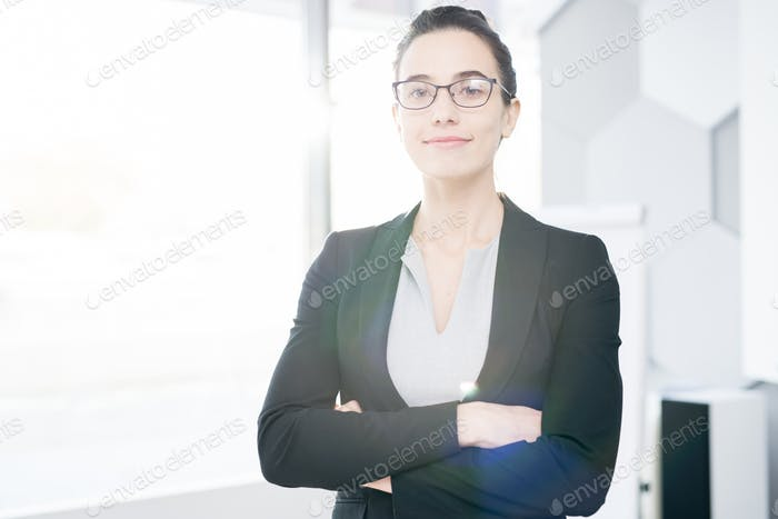 Confident Businesswoman Posing in Office