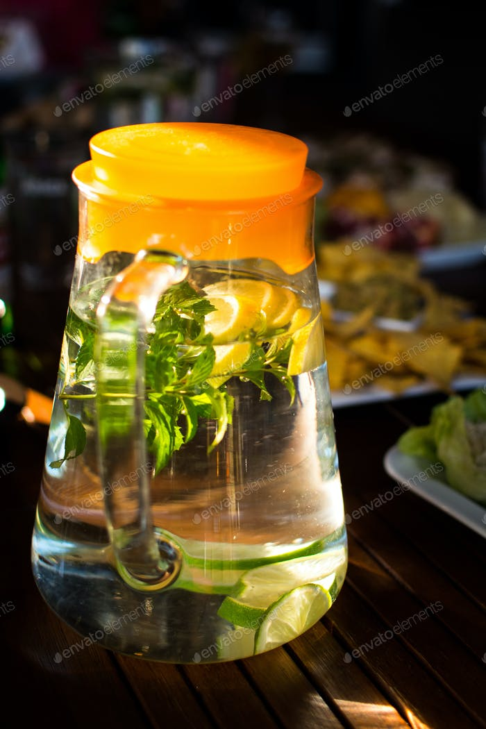 Jar of refreshing water with lemon and mint