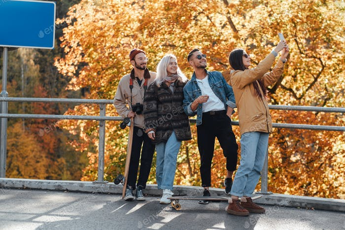 Autumn photography of four friends in public park