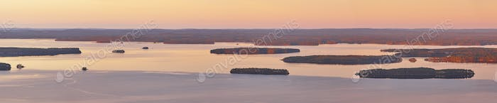Panoramic finnish landscape at sunset. Lake Pielinien. Koli viewpoint. Finland