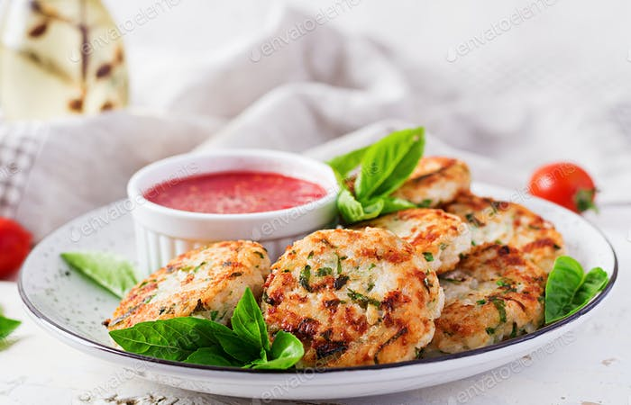 Delicious rice and chicken meat patties with garlic tomato sauce