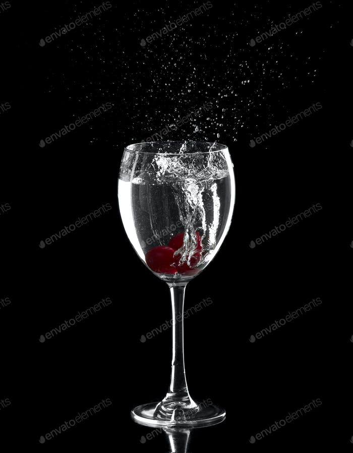splash, with red cherries splashing in to a glass