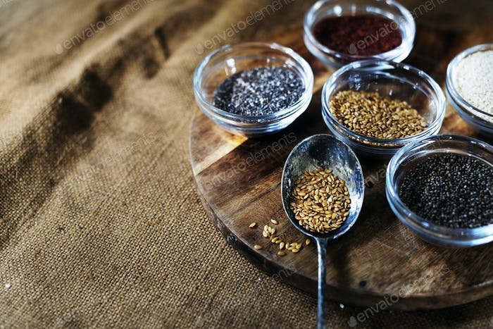 Aerial of seeds superfood on wooden board and spoon