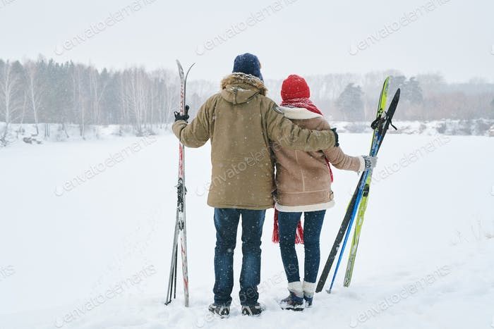 Couple Looking at Winter Forest