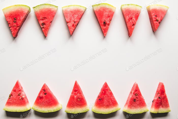 Slice of ripe and juicy watermelon , isolated on white. Top view