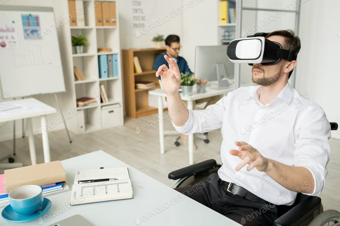 Businessman working in VR goggles