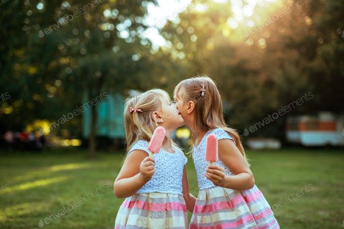Sisters enjoying sweets