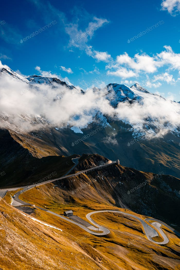 Dramatic Mountains and Clouds with Curvy Serpentine Road in Vall