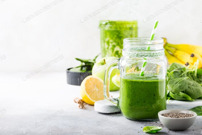Healthy green smoothie with spinach in glass jar