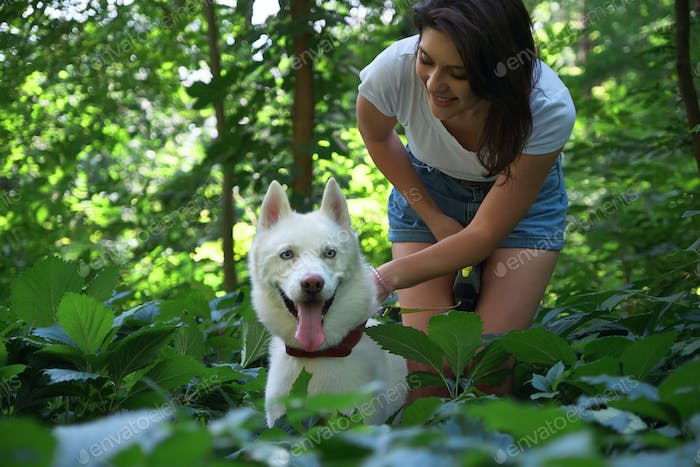 Woman spending time with her husky pet