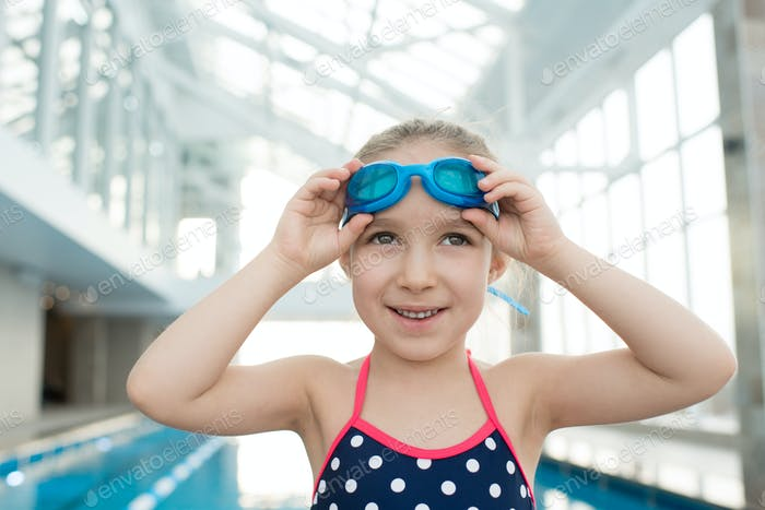 Cheerful girl at swimming training