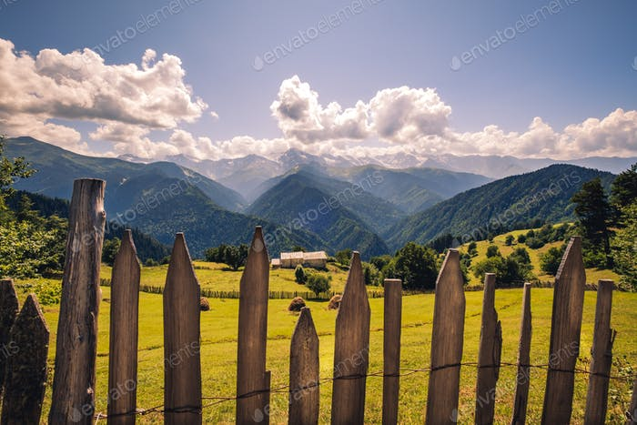 Landscape view of mountains, meadows and cottage in Svaneti, Georgia