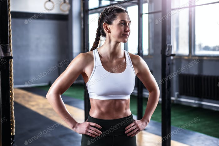 Sporty athletic woman in crossfit gym