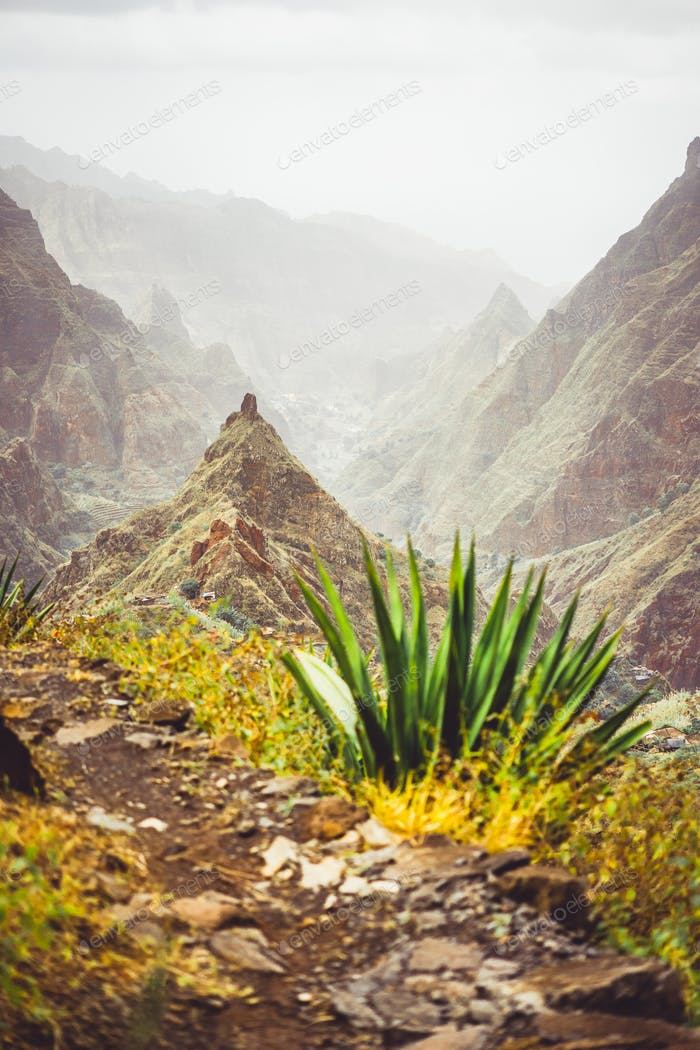 Mountain peak of Xo-xo valley and agaves plants on the trekking route down. Santo Antao island, Cape