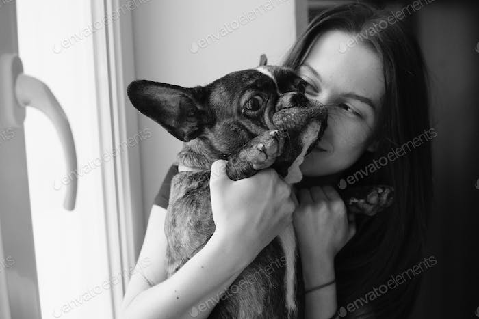 beautiful woman playing with small dog