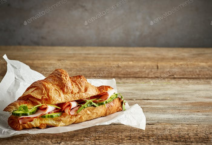 croissant sandwich with ham and cucumber