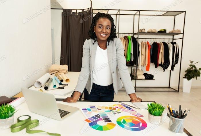 Cheerful Black Fashion Designer Smiling Working In Studio