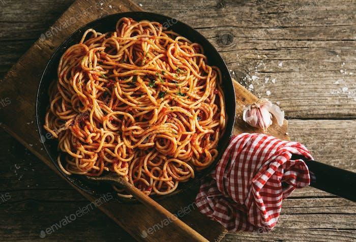 Italian spaghetti with tomato sauce in pan