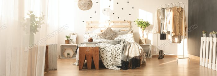Bed and dotted wall