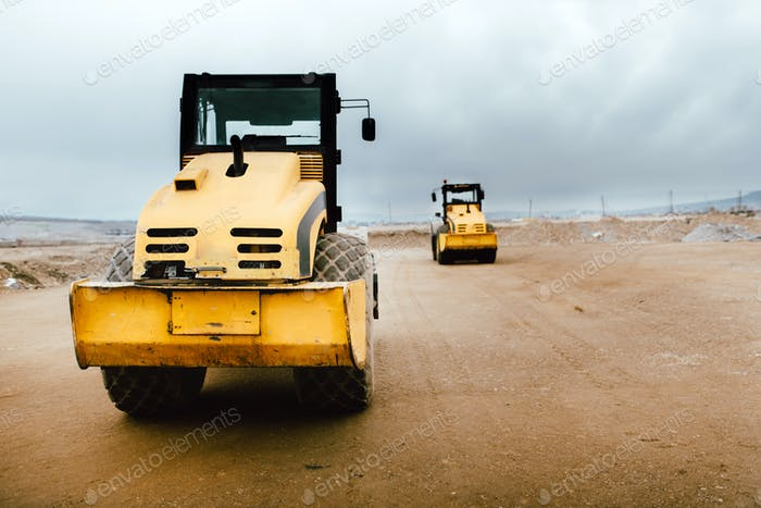 Industrial roadworks at highway with heavy-duty machinery