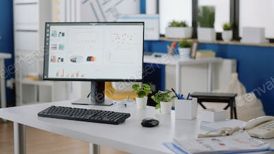 Nobody at desk in company office with computer and tools