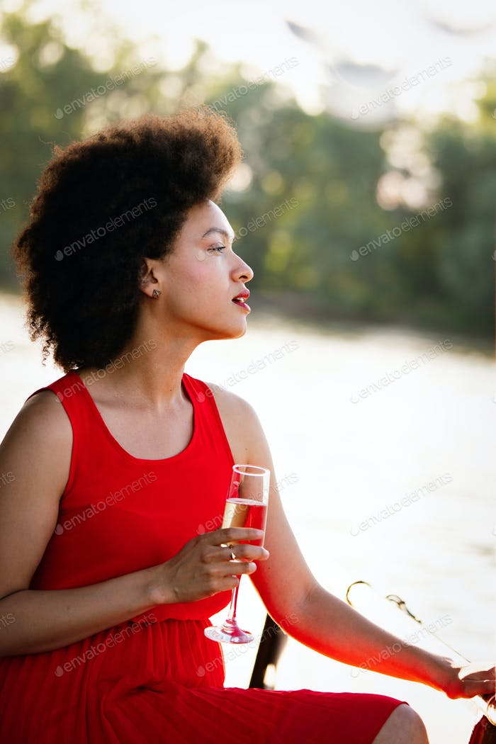 Portrait of a young black woman, model of fashion wearing dress with afro hairstyle