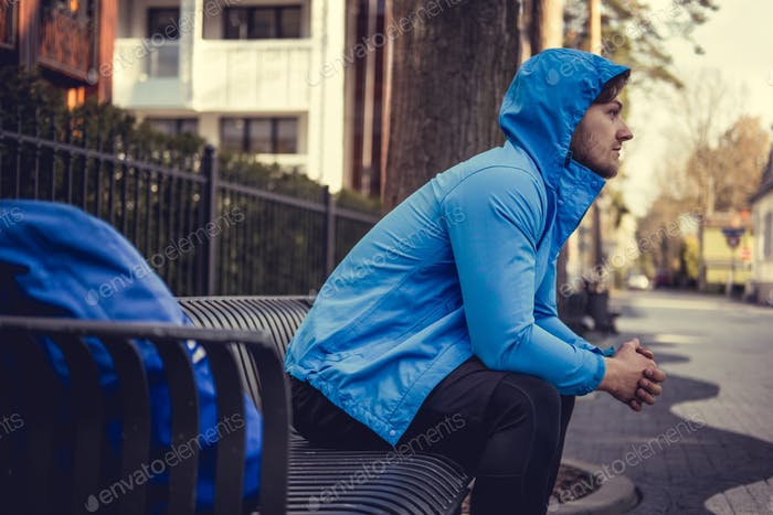 A man in a blue hoodie