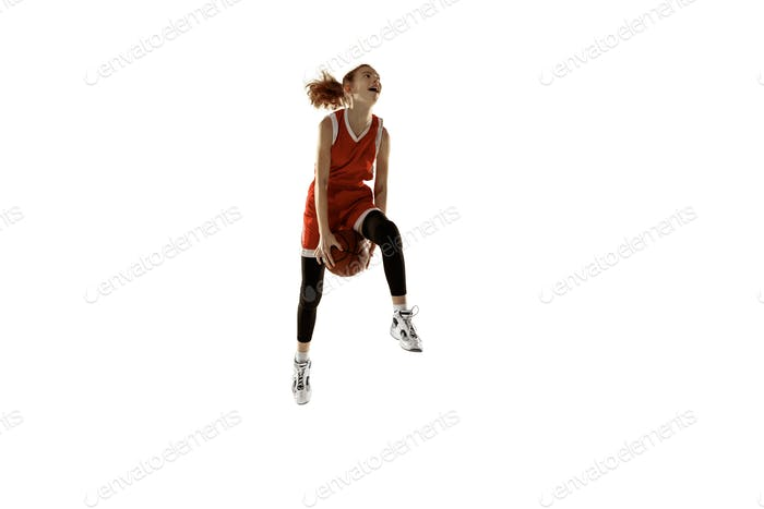 Young caucasian female basketball player against white studio background