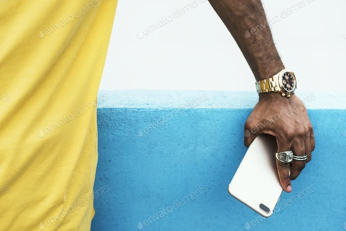 African man holding a smart phone