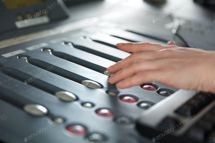 Radio Host Using Music Mixer In Studio