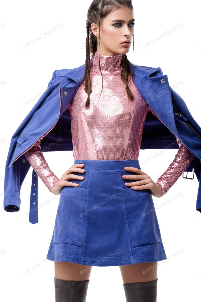 Portrait of beautiful lady standing in blue suede skirt and jacket and pink top with sequins