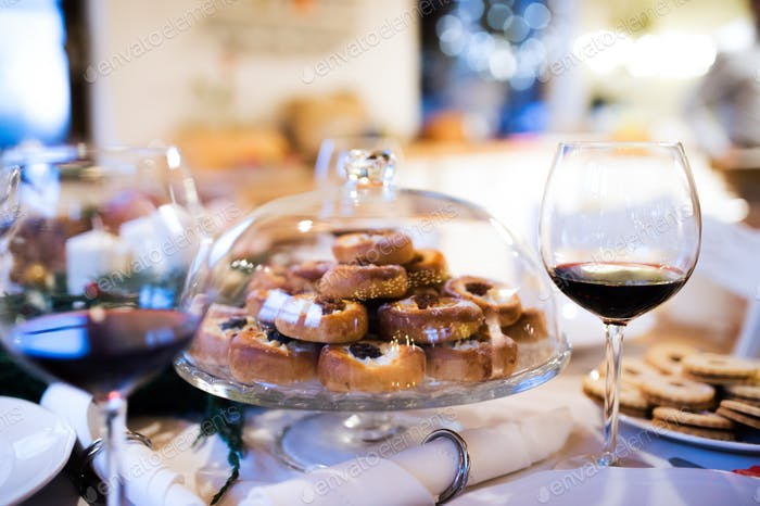 Christmas meal on a table. Pastry and red wine.