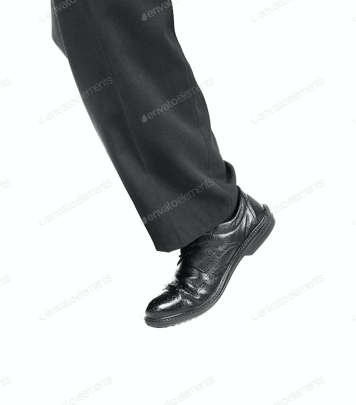 Feet of man in black shoes