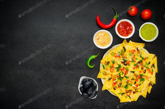 Nacho Tortilla Chips with Dip and Vegetables on Copy Space