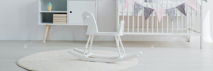 Rocking horse and white crib