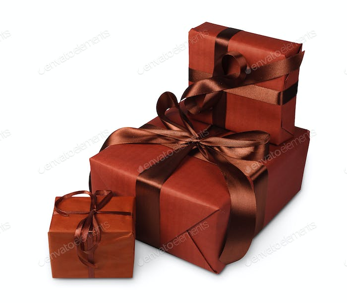 Christmas holiday gift boxes in brown paper isolated on white