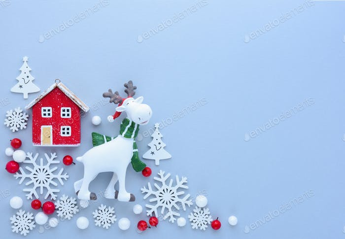 Christmas decorations on pastel blue background