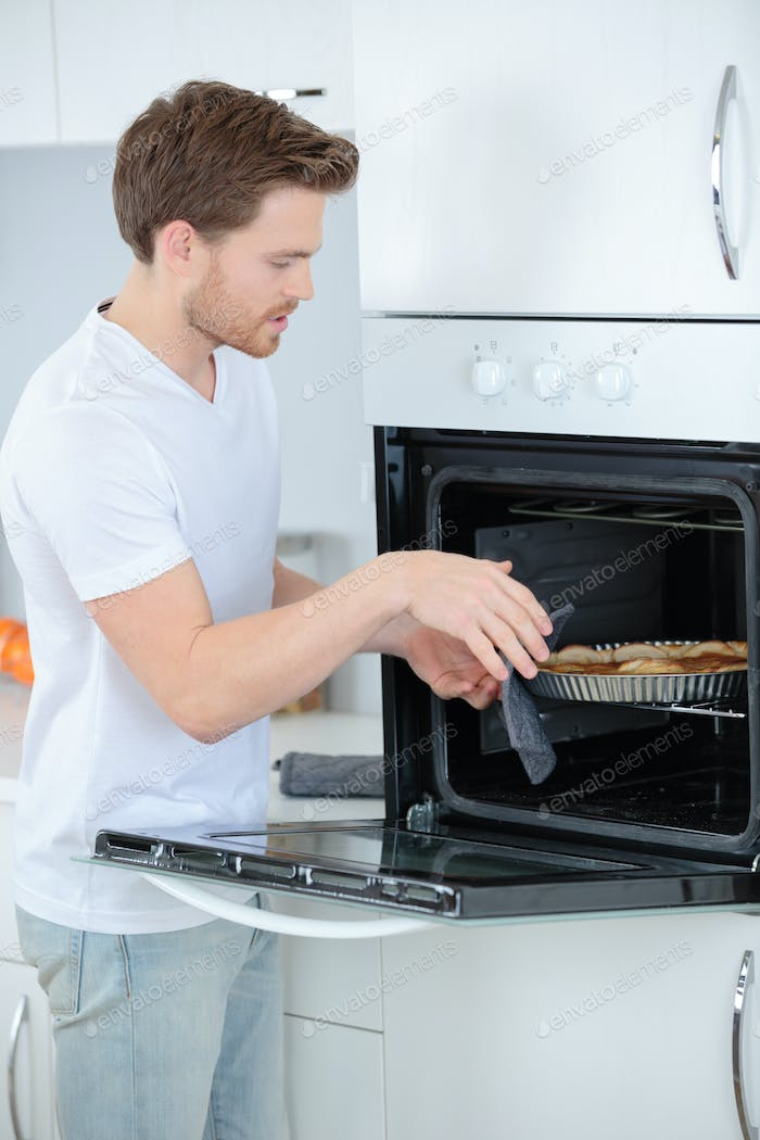 checking the food in the oven