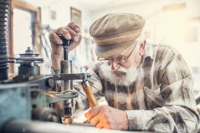 Senior man carving