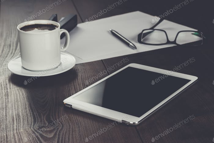 table of businessman with tablet computer and coffee