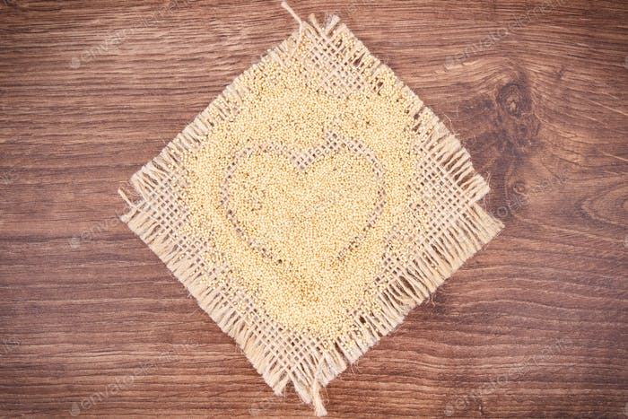 Amaranth in shape of heart, healthy food containing vitamins, minerals and dietary fiber
